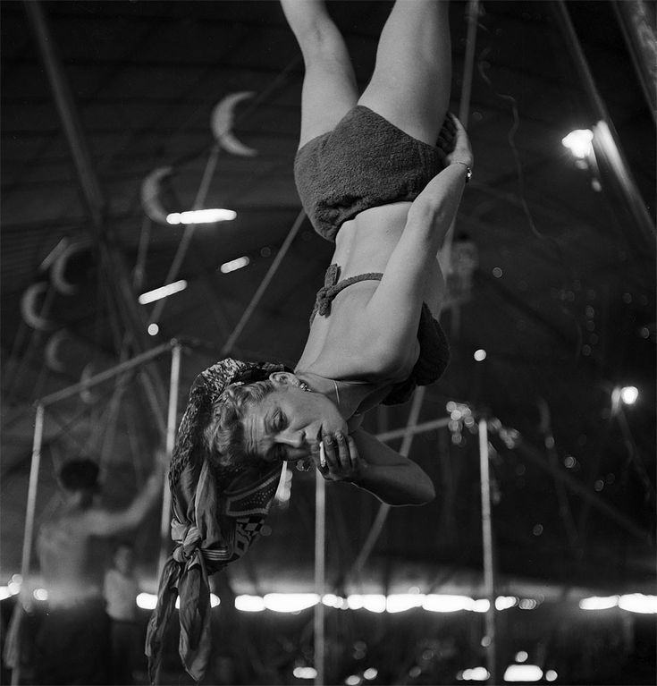 An aerialist smoking while rehearsing for the Ringling Bros. and Barnum & Bailey Circus in Sarasota, FL in 1949.