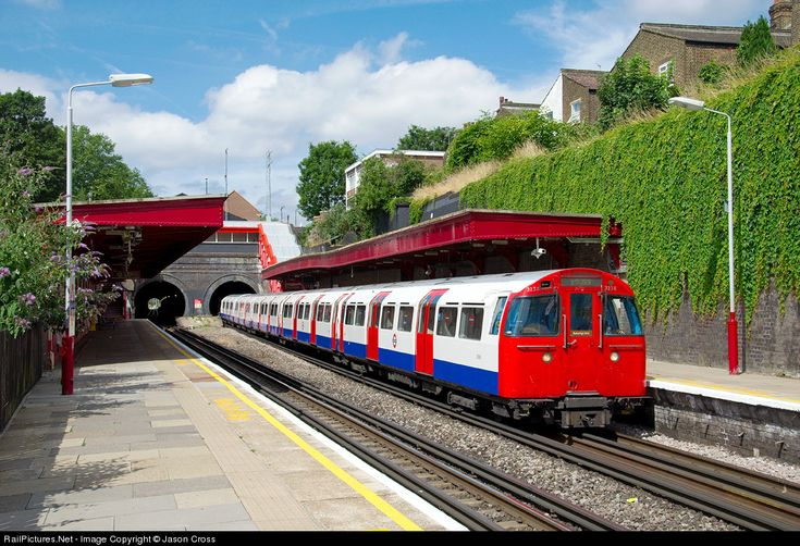 A train of 1972 mark 2 tube stock arrives at Kensal Green on the Bakerloo line of London Underground with a Harrow & Wealdstone to Elephant & Castle service.