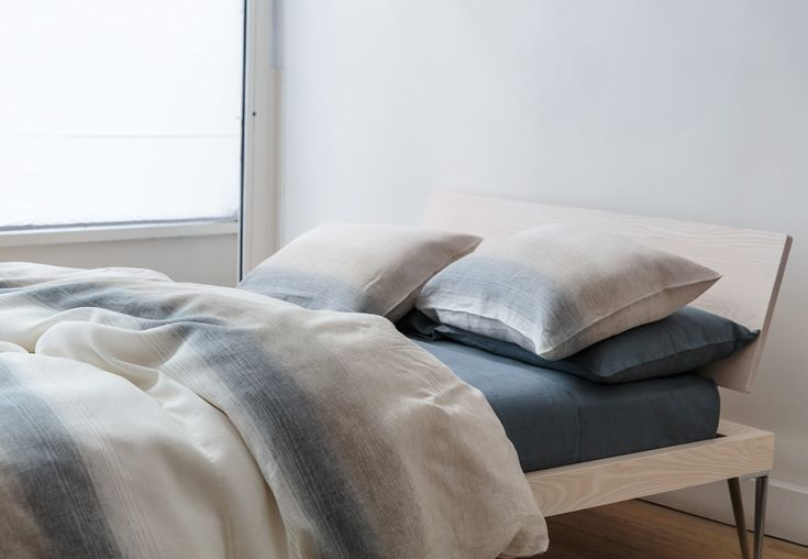 """How to Style a """"Masculine Bed"""" - TRNK.  How pretty!  The room is a little under-decorated but I love the bed/bedding!"""