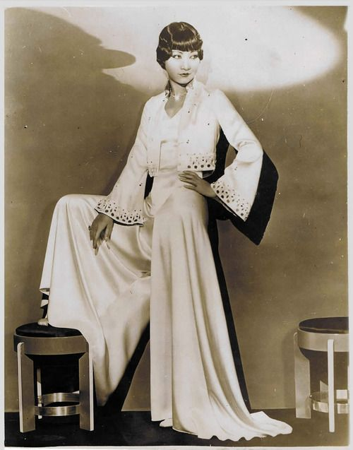 Anna May Wong,  abandoning the white bias-cut satin gown of the 1930s  with a white satin bias-cut jumpsuit. Too fabulous for words!