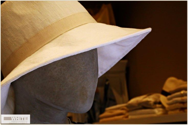 Like a diva. Cappello bianco in tela con fascia beige. Adatto per un look affascinante primaverile. https://www.facebook.com/whitearzignano #cappello #White #modadonna #ss15 #womanswear