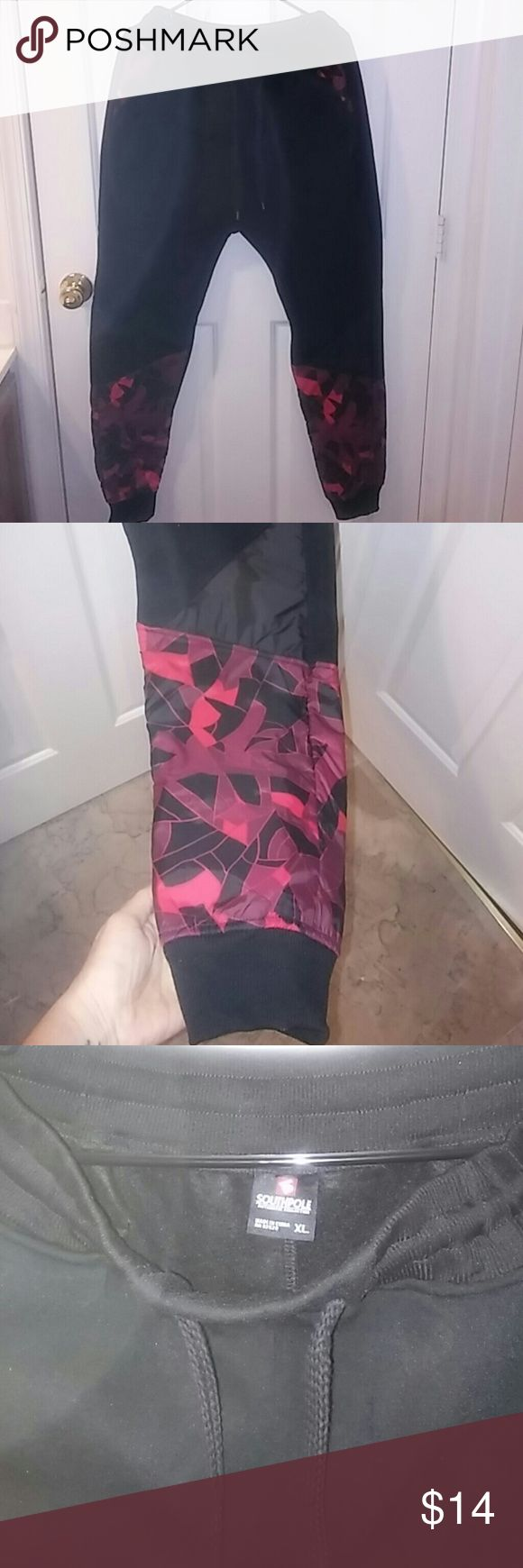 Men's black and red jogger pants Men's black jogger pants with red pattern around leg. Excellent condition...only worn a couple of times. South Pole Pants Sweatpants & Joggers