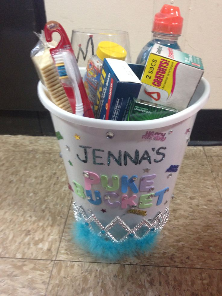 Puke bucket for my friends birthday :) contains Gatorade, toothbrush, crackers, Advil, gum, tums, garbage bags, and a painted wine glass. All from the dollar store!