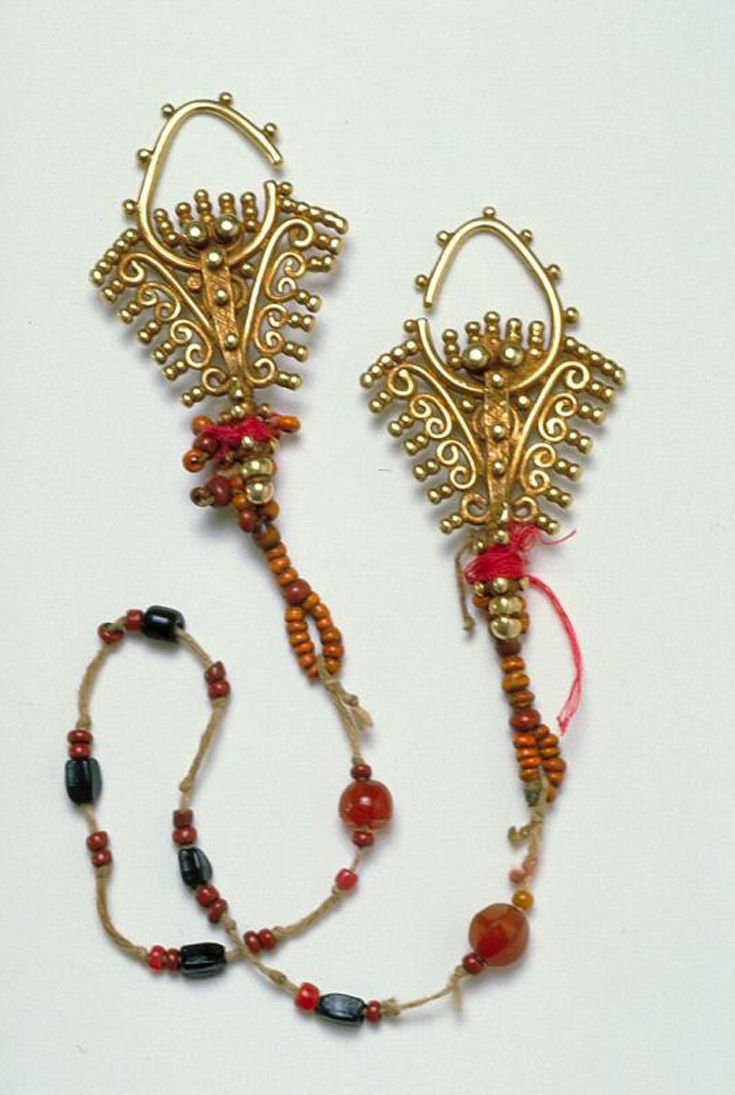 Indonesia ~ Tanimbar Islands, Maluku Province.  Pair of ear ornaments; gold with granulation and 'muti slah' beads.  19th century