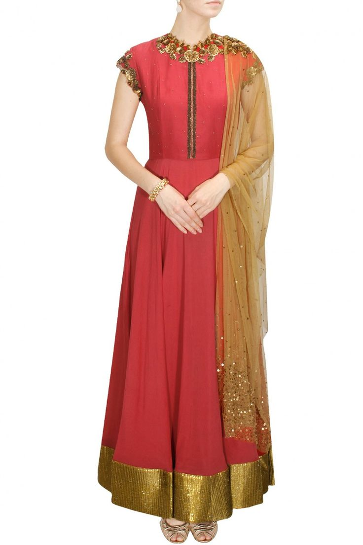 This red colour anarkali salwar kameez made in gorgette fabric. Yoke part of this anarkali salwar kameez is made in raw silk fabric having beautiful neckline in zari. Border of this anarkali suit is m