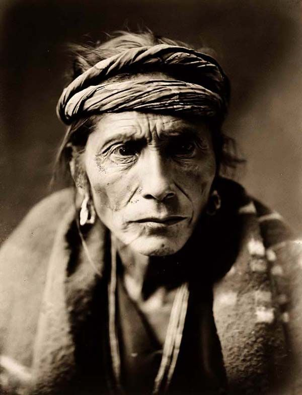 "Here for your consideration is an aesthetic picture entitled ""The Patient"". It was created in 1905 by Edward S. Curtis.  The picture presents a Portrait of an old, sick, Navajo man facing front, with a rag headband, and a blanket over shoulders."