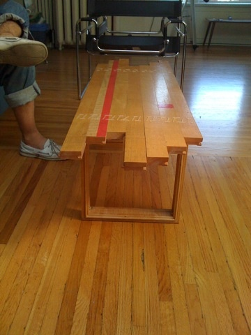 Recycled squash court lumber coffee table.