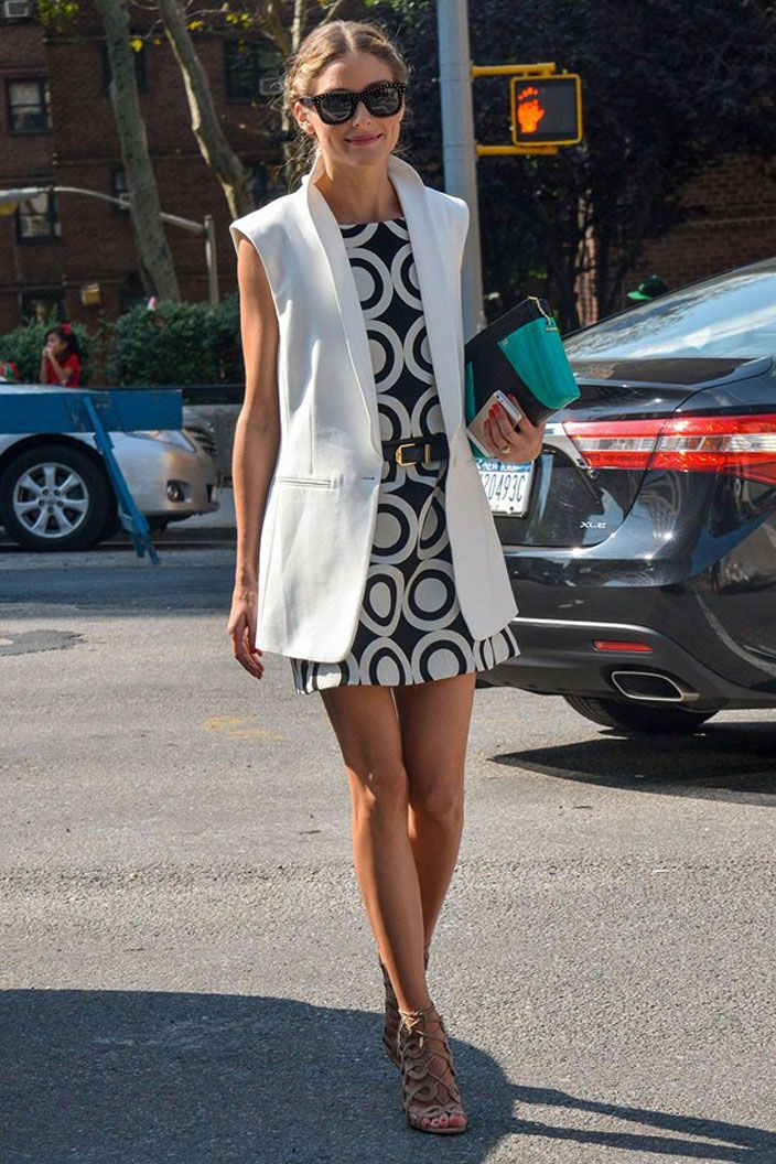 White sleeveless coat and geometric print dress.