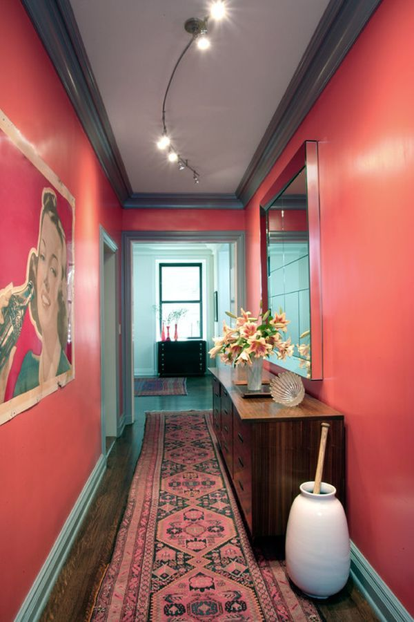 The Drama Of Coral Colored Walls Is Balanced With Gray Ceiling And Black Trim