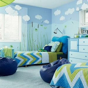 "Shades of blue pair with green to create an amphibian-theme room, perfect for the boy who is forever catching frogs and turtles, and asking, ""Can we keep him?"" A wall mural evokes a by-the-pond look, and durable cotton bedspreads and pillowcases will stand up to rough boy antics. Consider using built-in shutter shades on windows rather than bulky curtains."