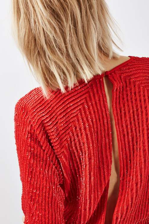 Let the search for the perfect going-out top end with this red batwing-sleeve top in all-over sequin with a cool open-back detail. Style with a trophy skirt of cropped jeans for a more casual feel. #Topshop