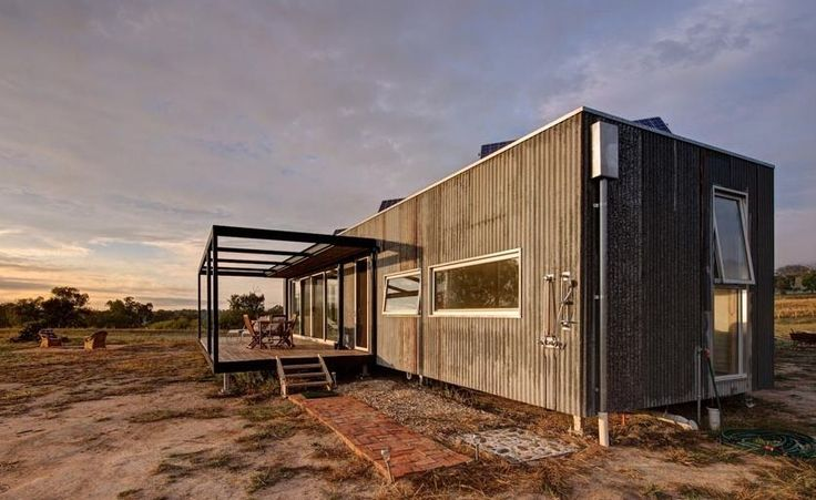 This modern solar-powered off grid cabin by Modscape has solar panels, rainwater collection system, and a septic tank installed on the property. Inside there's a master bedroom, full bathroom, open...