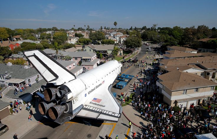 Endeavour slowly makes its way through a Los Angeles neighborhood on October 13, 2012. (AP Photo/Jae C. Hong)