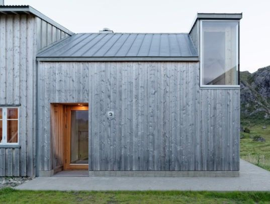 Carl-Viggo Hølmebakk created Summer House Gravråk, a spruce-clad retreat on Norway's Lofoten archipelago.