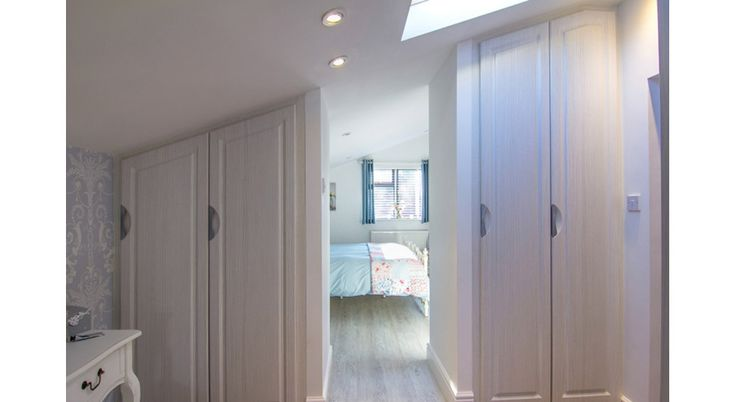 Hacienda white hinged doors in eaves. Below is a link to our online calculator to see how much your bespoke made to measure wardrobe will cost http://www.foxwardrobes.co.uk/instant-online-estimator/