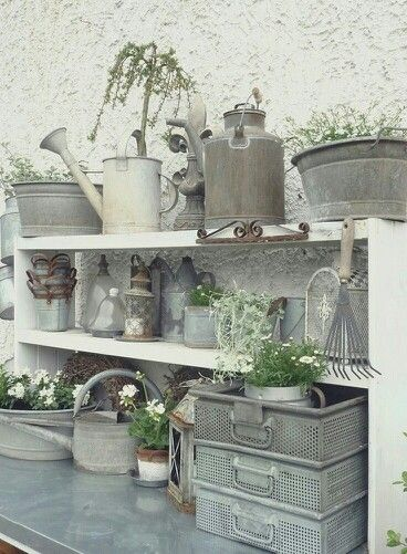 Textures and soft colors of the galvanized metal containers and watering cans