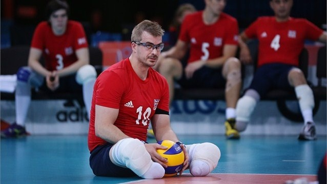 Charles Walker of Great Britain waits to serve during the men's Sitting Volleyball 5-8 Clasification match against Brazil on Day 8 of the London 2012 Paralympic Games at ExCeL.