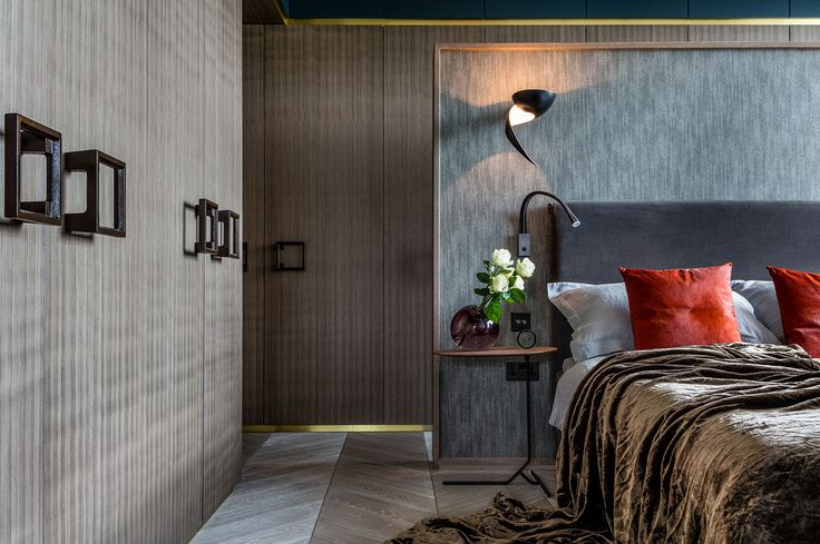 Luxury bedroom design with wooden wardrobes and modern bedside lighting - The Rovers Return Luxury interior designs by Daniel Hopwood and Studio Hopwood. Designs featuring on the Martyn White Designs Blog