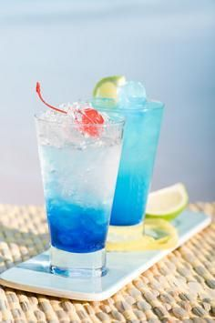 Original Blue Lagoon  Ingredients  2 oz Vodka  1 oz Blue Curacao  Lemonade  Ice  Cherry, for garnish  Procedure    Take a cocktail shaker and pour the Blue Curacao, José Cuervo, 7-Up, and lime juice in it. Fill the shaker with ice cubes and the pineapple juice now. Close the cocktail shaker and mix vigorously. Strain the beverage into a margarita glass with ¼ of it filled with ice cubes. Serve immediately.