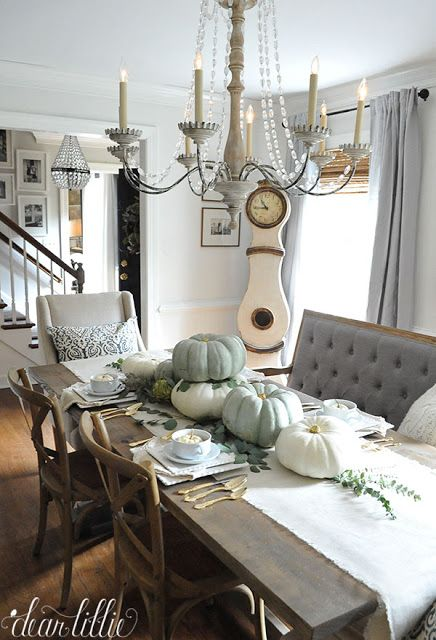 Mixing up your seating with items like this tufted bench from HomeGoods helps add interest to a dining room! (sponsored pin)