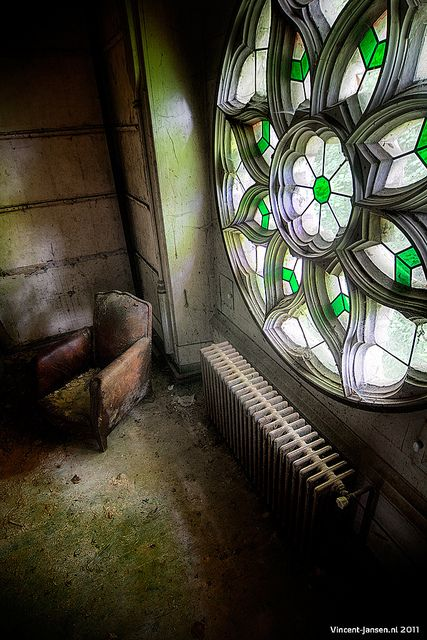 Beautiful stained glass window remains in an abandoned building