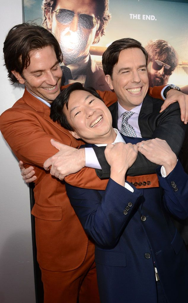 """Bradley Cooper, Ken Jeong, and Ed Helms hug it out at the Los Angeles premiere of """"The Hangover Part III"""", the series big send-off."""