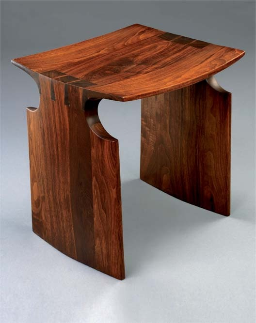 David Ebner, black walnut stool,1974. Beautiful shape and wood colour. But why not make all three parts the same shape and recess the legs. More difficult but would look great.