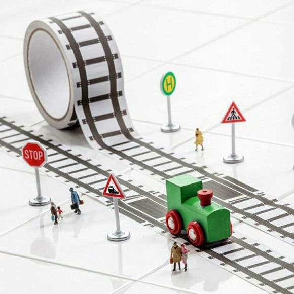 These fun & simple DIY tracks, roads, and towns offer hours of simple fun for kids. Railroad track tape + DIY cardboard town = happy little campers!
