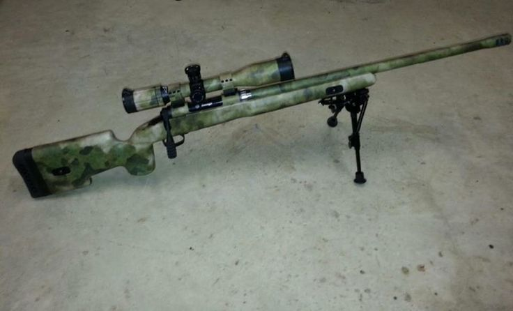 Savage Model 11 Chambered in 308 with upgraded Choate Stock, Threaded Heavy Barrel with Ross Schuler Muzzle Brake Installed, SWFA SS 16x42 Mil/Mil Scope/Butler Creek Caps, Vortex Tactical Rings and tactical bolt handled. Applied A-Tacs FG #gunskins. Took about 7 hours of total work to get everything covered.