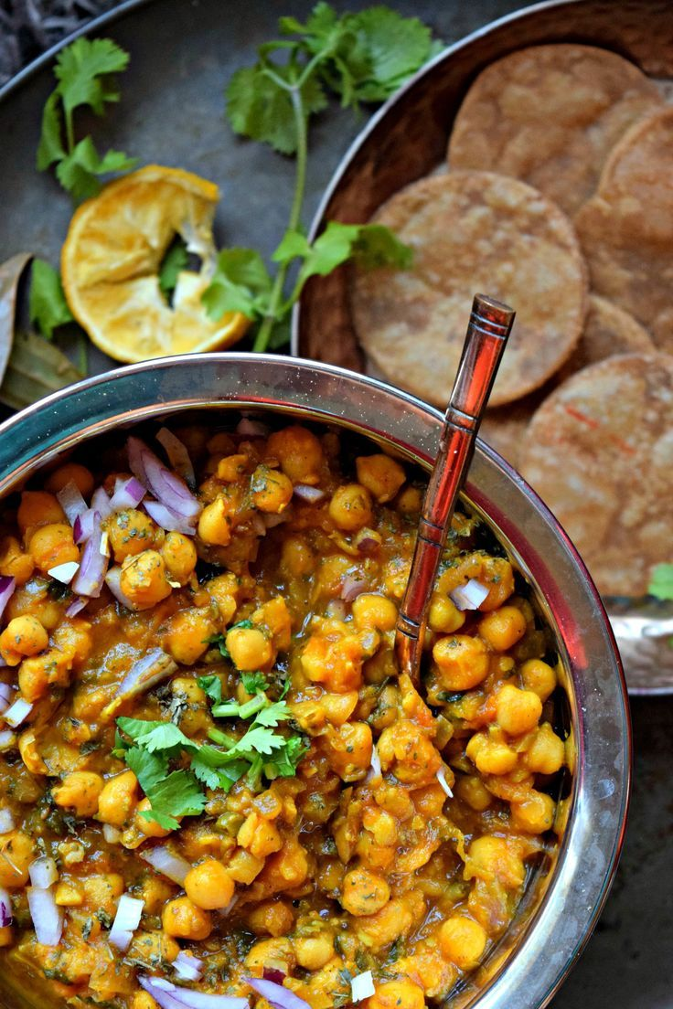 Simplest Punjabi Chana/Chickpea Masala Ever! - Punjabi Chana Masala is a tried and tested simple North Indian recipe. Chickpeas are cooked with Indian spices and is one delicious dish! Serve with roti/rice.