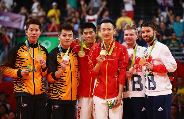 (L-R) Silver medalists V Shem Goh and Wee Kiong Tan of Malaysia, gold medalists Haifeng Fu and Nan Zhang of China, and bronze medalists Marcus Ellis and Chris Langridge of Great Britain stand on the podium during the medal ceremony after the Men's Badminton Doubles competition on Day 14 of the Rio 2016 Olympic Games at Riocentro - Pavilion 4 on August 19, 2016 in Rio de Janeiro, Brazil.