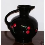 2008. GENUINE HOMER LAUGHLIN CHINA, CONTEMPORARY FIESTA® Fiesta® ware Wild Cherry Louis Vuitton Carafe. NEW Black Carafe with the Cherries made first for Betty Crocker who has closed her factory store.