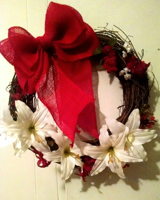 grapevine wreath with lillys and red burlap bow for a friend