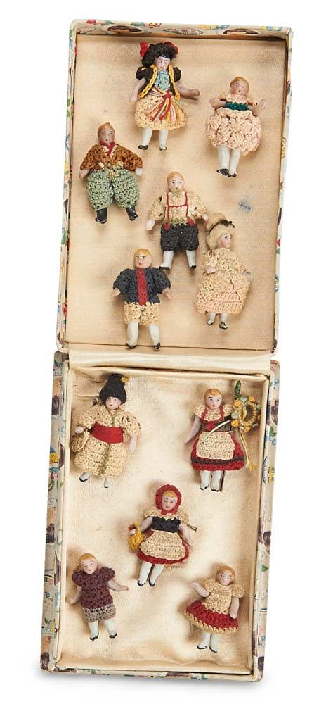 """Eleven Tiny German All-Bisque Dolls in Original Knit Costumes 1 1/2"""" (4 cm.)s"""