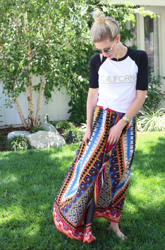 Try wearing a cool baseball T-shirt knotted up with a long bold maxi skirt. Look for a fun colorful print, another easy look with a lot of impact and completely comfortable!