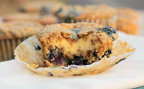 Oatmeal Blueberry Cream Cheese Muffins An extraordinary soft tender blueberry muffin.  Made with oatmeal and an orange flavored cream cheese filling. #muffin #blueberry