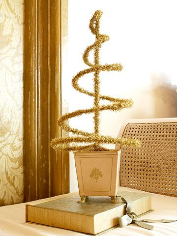 Wrap a spiral-wire topiary with tinsel garland and place it in a pot filled with florist's foam to create this golden beauty.