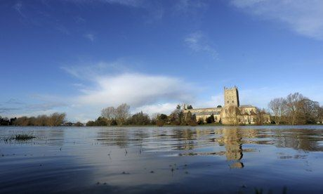 Flooding outside Tewkesbury Abbey, Gloucestershire, following the Christmas storms that swept Britain. Photograph: Tim Ireland/PA