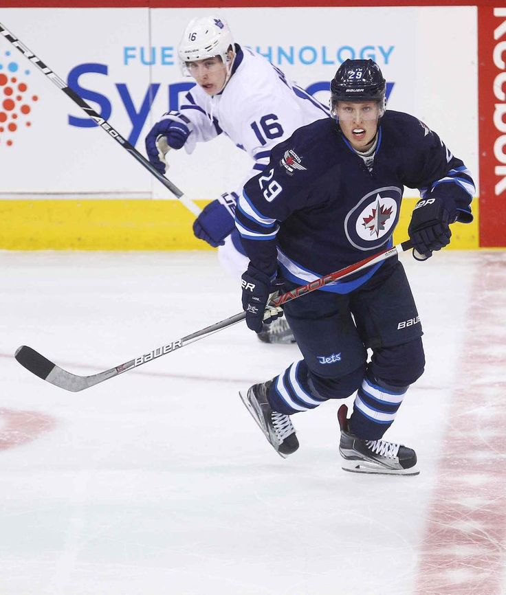 MIKE DEAL / WINNIPEG FREE PRESS</P><P>Winnipeg Jets Patrik Laine (29) and the Toronto Maple Leafs Mitchell Marner (16) during the game at the MTS Centre Wednesday evening.