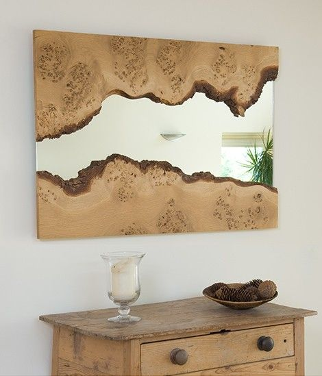 The Mirror flows between the two slices- the smoothness highlighting the rough and rustic appearance of the wood. -by Caryn Moberly.