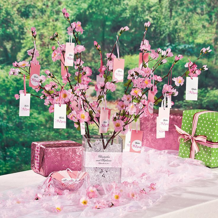 """Create a lovely table centerpiece to complete your Cherry Blossom wedding theme. This """"Wishing Tree"""" is as beautiful as it is useful. Follow the directions to create your own and add a unique style to your wedding reception. It's simple with cherry blossom branches, clear ice, a vase and a few decorative touches. Personalize your own Cherry Blossom Wishing Tree for your special day!"""