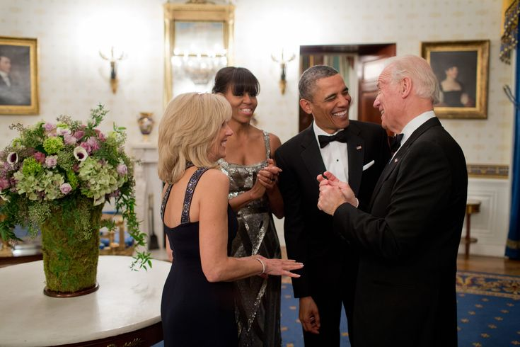 President Barack Obama and First Lady Michelle Obama talk with Vice President Joe Biden and Dr. Jill Biden in the Blue Room of the White House before the National Governors Association Dinner, Feb. 24, 2013. (Official White House Photo by Pete Souza) This official White House photograph is being m