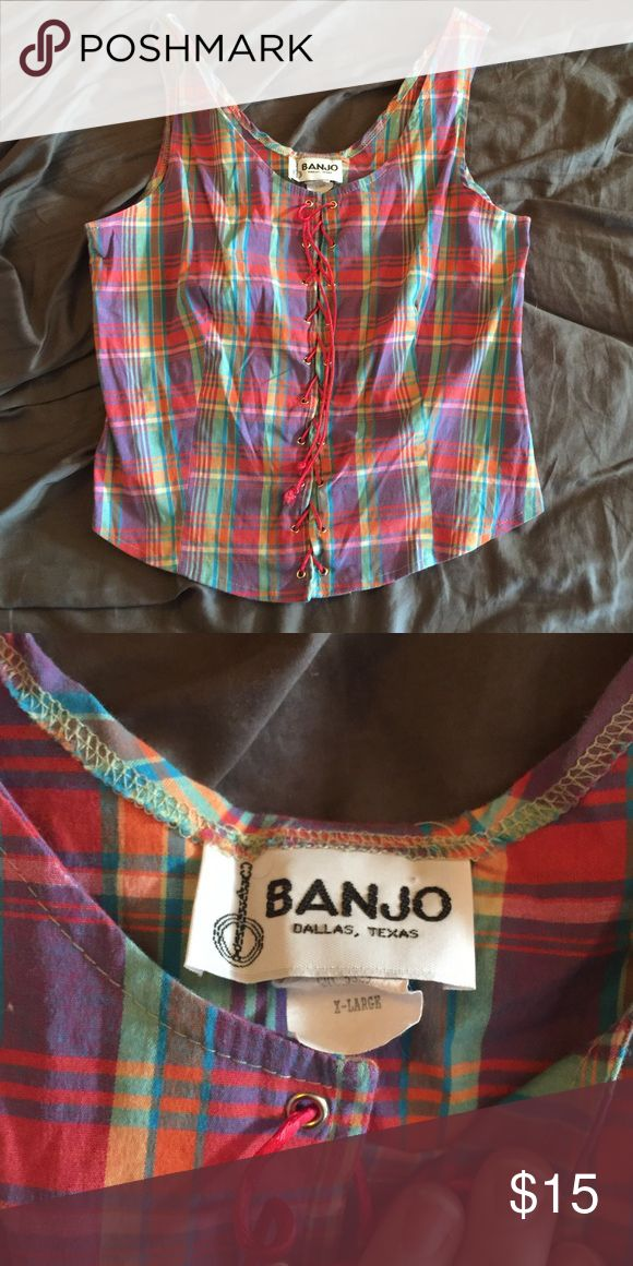 Last call! Plaid, lace up corset style top This shirt is adorable! It's got a bit of a retro/pinup vibe to it. Features a great, colorful plaid, and red laceup. EUC! Not a lot of stretch to this one, but you can loosen up the lacing a bit. banjo Tops
