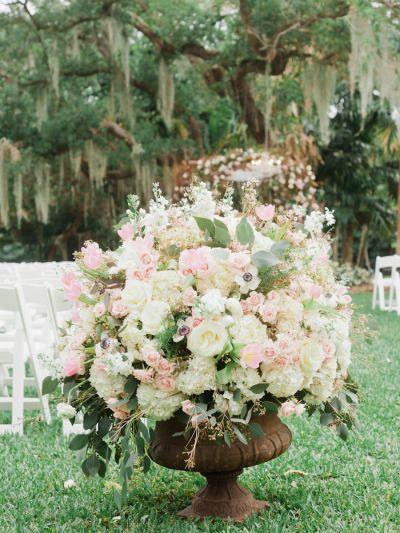 Gorgeous wedding flowers: http://www.stylemepretty.com/florida-weddings/2015/05/28/miami-kampong-gardens-spring-wedding/   Photography: Merari - http://merari.com/