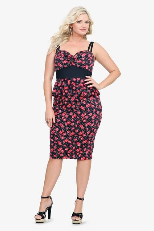 This fashion bug vintage-inspired black wiggle dress has a flirty red dice  print and a cute pop of plus size peplum.