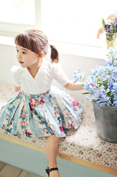 Amaya loves the blue and flowered skirt. She likes the pretty white top.