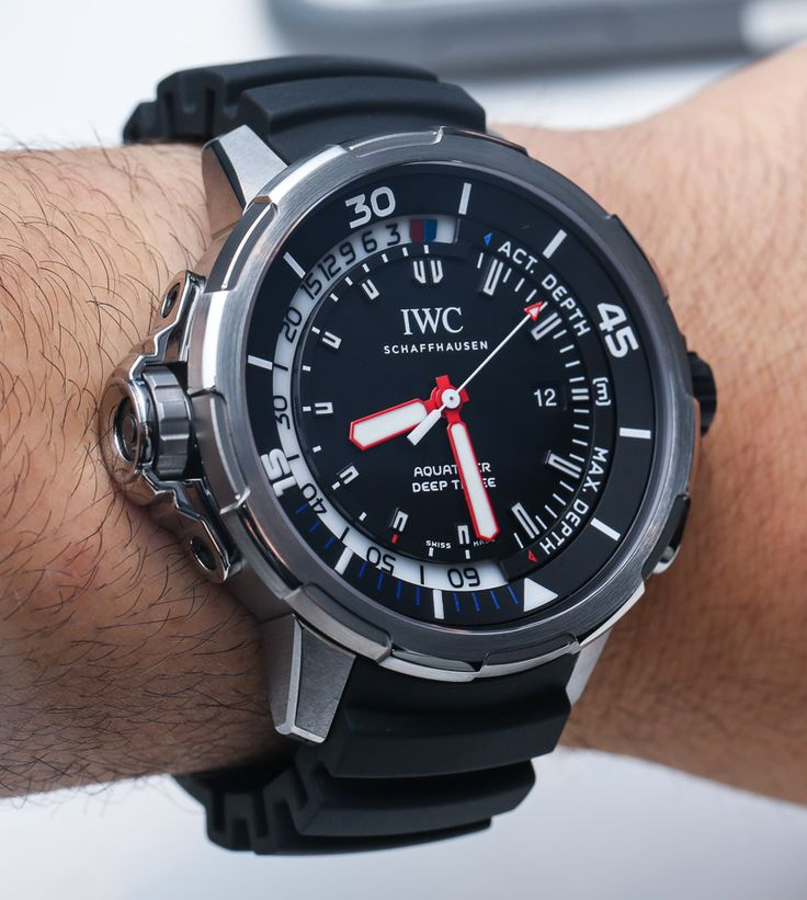 IWC Aquatimer Deep Three Depth Gauge Watch... The IWC Aquatimer Deep Three contains IWC's mechanical depth gauge system that does two things. It measures your current depth to a max of 50 meters, and it also indicates your max depth for a particular dive. 50 meters might not sound that deep, but it is more than OK for recreational dives. The system is easy to read and uses a red and blue indicator hand around the periphery of the dial. A pusher allows you to reset the max dive depth hand…