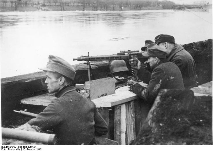 """German-Soviet front, near Frankfurt on the Oder on 15.2.1945: A MG-position of the """"Volkssturm"""". Hitler's last contingent on the bank of the Oder. This was literally the last stand, with the remnants of German manpower putting up a desperate last fight to stop the Soviets from rolling into the German capital, which inevitably came 3 months later."""
