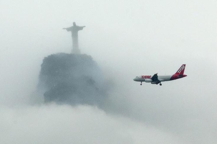 TAM Linhas Aéreas Airbus A320-232 passing by Christ the Redeemer in Rio de Janeiro, December 2011. (Photo: AP)