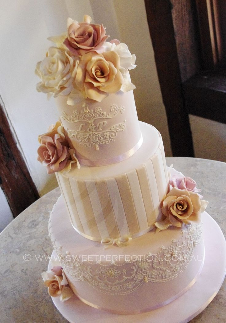 Blush, ivory and pale gold wedding cake. Robert's Restaurant, Pokolbiin, Hunter Valley. August 2014. Handmade sugar roses in latter, cream and dusty pink. Ivory royal icing piping based on bride's gown lace.